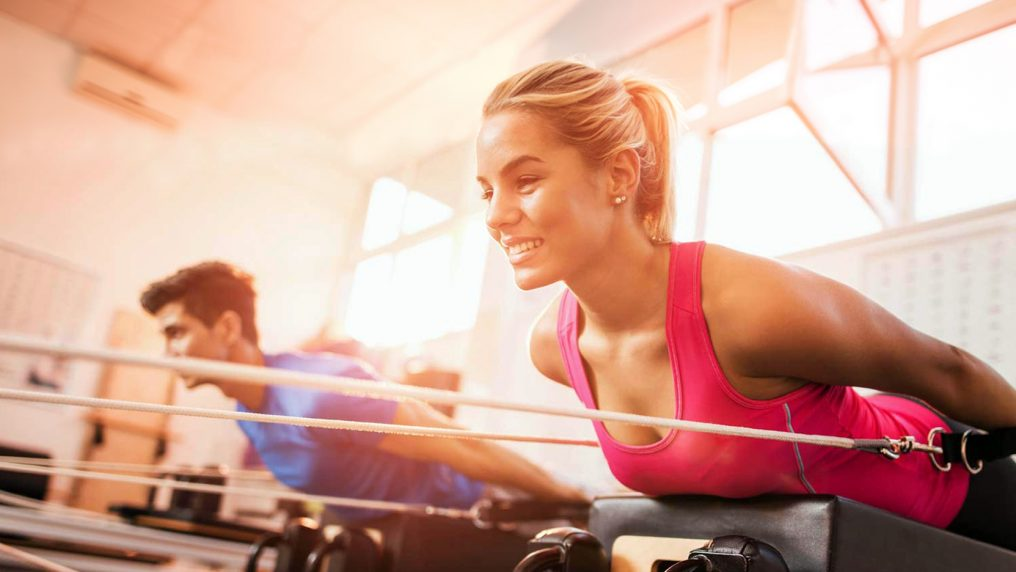 Mat vs. Reformer Pilates: What's the Difference?